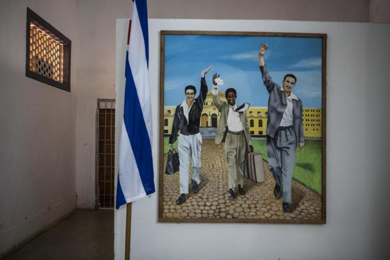 A painting depicting Raul & Fidel Castro (and comrade) being released from Presidio Modelo on May 15, 1955.