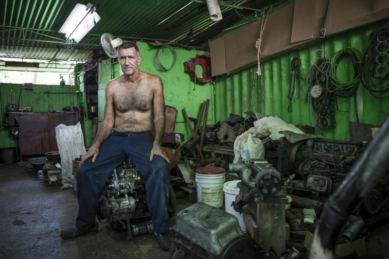 A mechanic in his machine shop, Quivican.