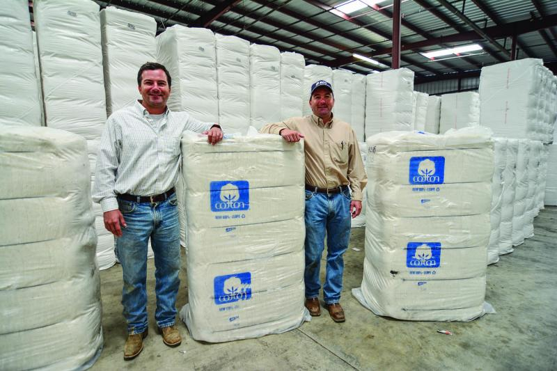 Keath (left) and Heath Killebrew, in the warehouse that stores cotton processed from their fields. Greenwood, MS, March 2014.