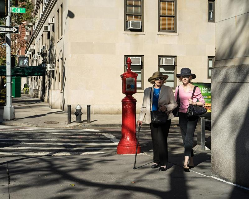 Women walking up Park Avenue, Upper East Side, New York.