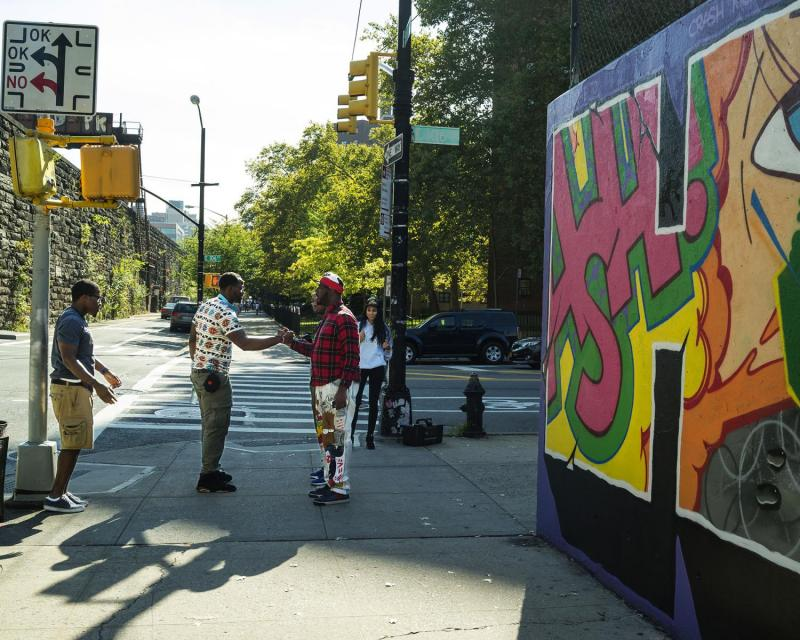 Corner greeting, Park Avenue, East Harlem, New York.