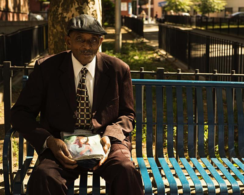 Jehovah's Witness relaxing, South Bronx, New York.
