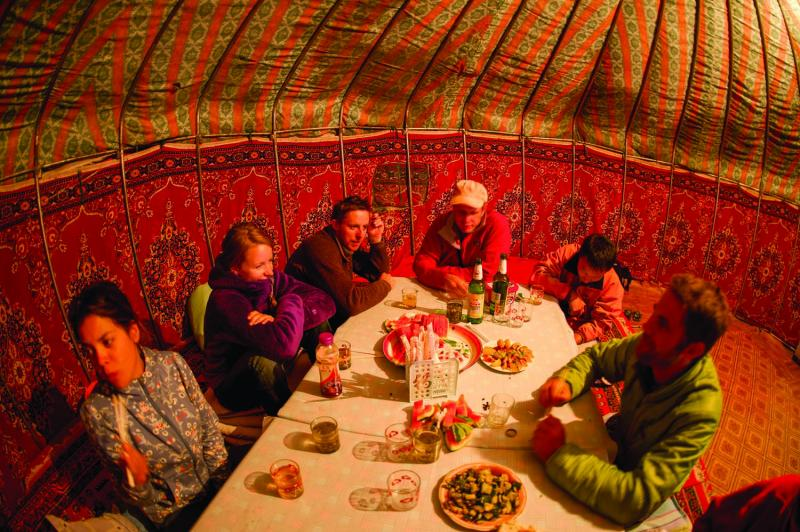 The climbing team relaxing inside a traditional Kazahk yurt. In the team's perspective, the perfect  traveling home.