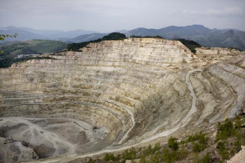 The open pit of Rosia Poieni, a large copper mine not far from Rosia Montana, shows the devastation of strip mining.