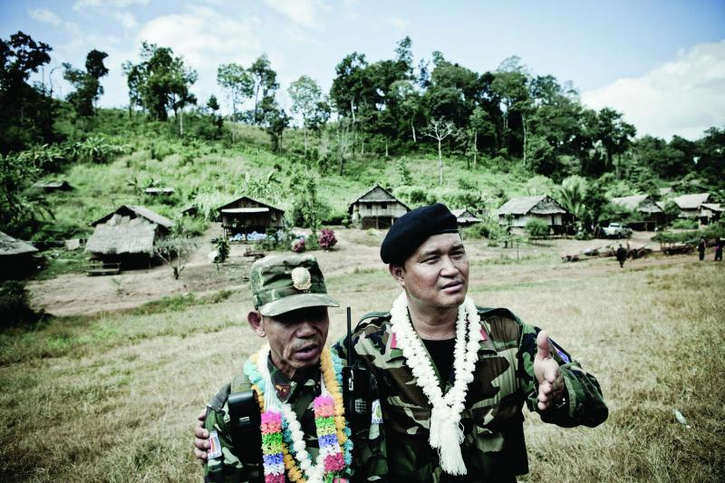 Colonel Nerdah (right) of the KNLA (Karen National Liberation Army) and Colonel Steele (left) of the DKBA (Democratic Karen Buddhist Army) at a truce ceremony in the village of Oo Kray Kee 3.7 miles inside of Burma from Thailand.