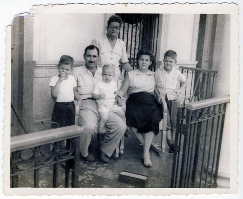 Paul and Rubí, along with the three boys and Rubí's mother, in Quivican. (Image courtesy of the author)