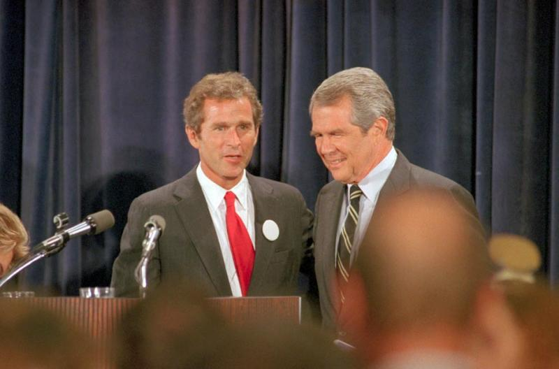 Robertson and a young George W. Bush before the Michigan delegation to the Republican convention in 1988 (Joe Polimeni / Bettmann / Corbis).