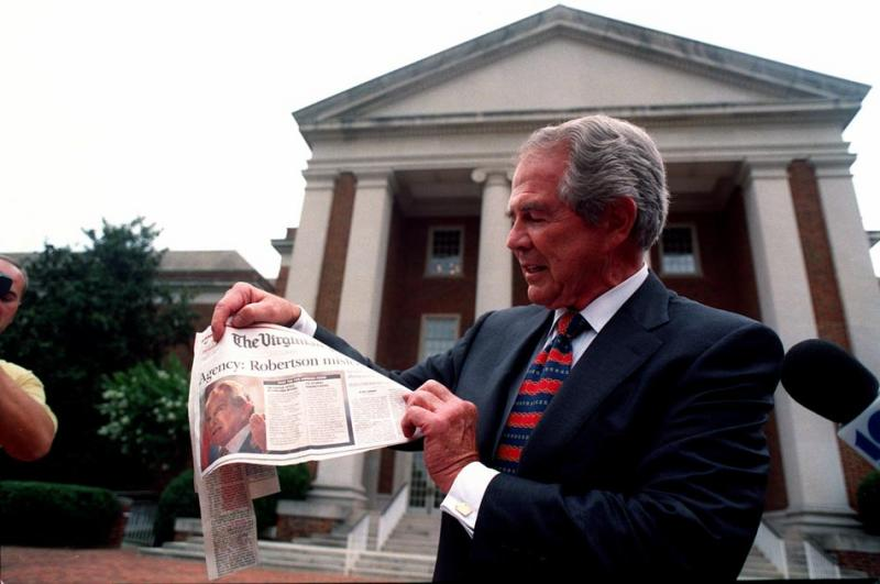 Robertson denounces a newspaper story about his African diamond-mining operation at a press conference outside Christian Broadcasting Network headquarters in Virginia Beach in 1999 (Steve Earley, The Virginian-Pilot).