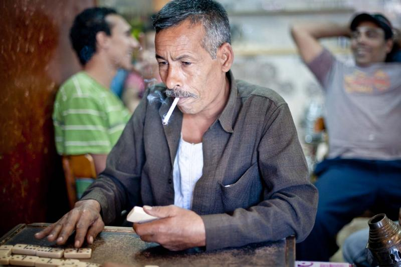 Boys and men of all ages pass their free time in Cairo's numerous cafés. They smoke cigarettes and shisha while playing dominoes and cards and, until recently, avoiding talk of politics.