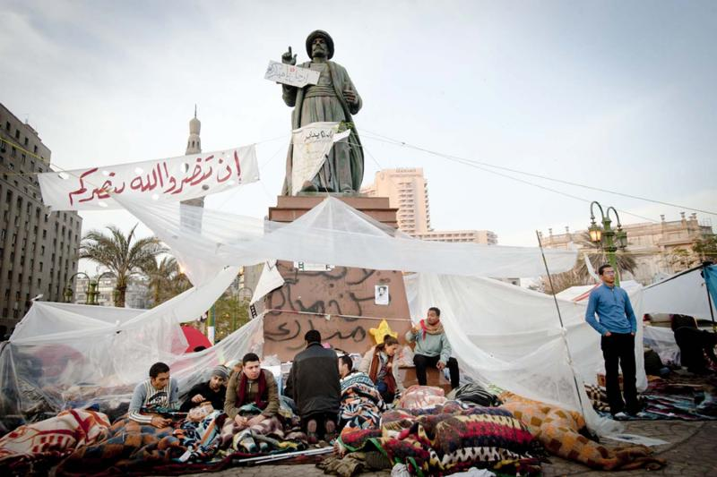 Protesters built temporary encampments in Tahrir Square, and hundreds of Egyptians, like these set up at the foot of the statue of Omar Makram, slept in the square at night.