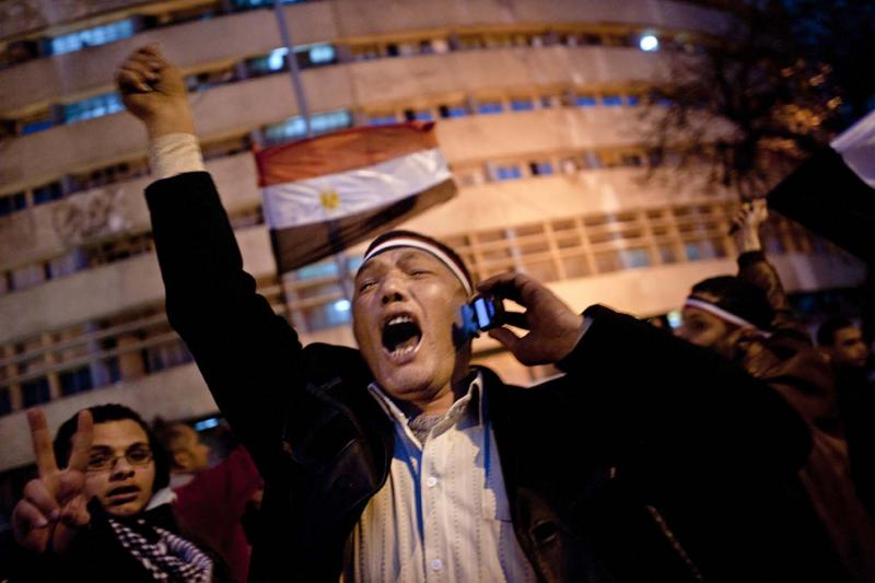 An Egyptian protester erupts in joy at the news—received via mobile phone—that President Hosni Mubarak would resign following eighteen days of protests.