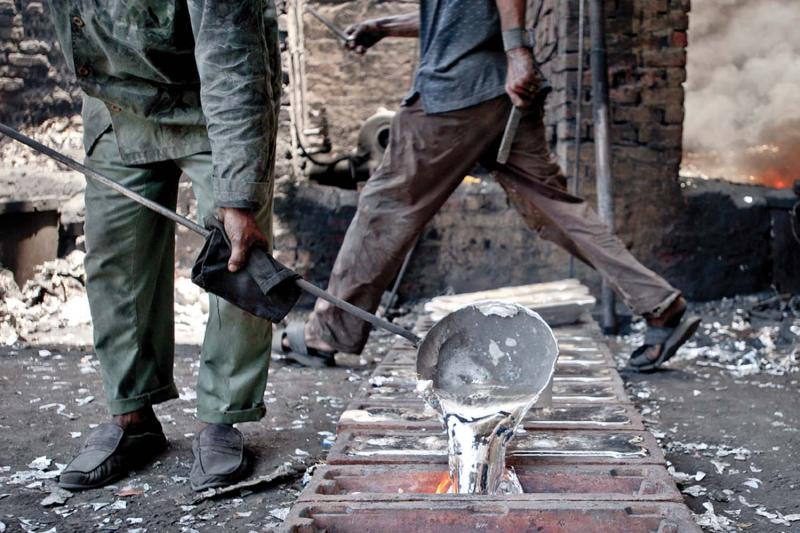 Aluminum smelters at a major informal factory melt down heaps of used aluminum foil to produce ten-kilo ingots, which are later used to produce cookware and silverware sold in Egypt's street markets.