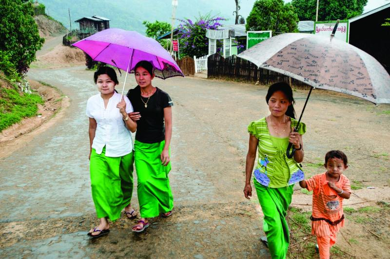 Villagers walk the main street of Layshee during one of the first showers of the rainy season.