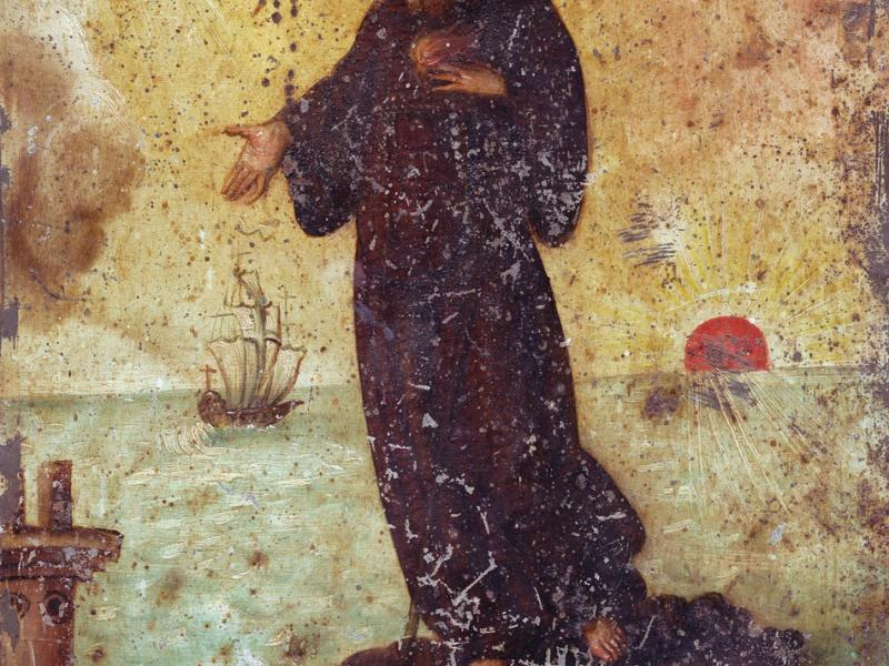 Saint Francisco de Paola floating across the water on his cloak. A saint of good works—charitas bonitas—he is carrying flames against his chest, a physical manifestation of his passion for the word of God.