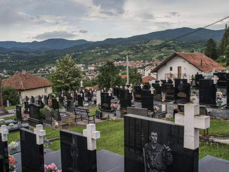 A cemetery in Višegrad dedicated to Serb soldiers. Višegrad was the site of a 1992 Serb assault on Bosniak civilians. There were few reported Serb casualties. Experts say that Serb soldiers killed elsewhere are buried here as part of a larger revisionist effort. June 2020.