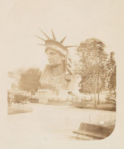 """Head of the Statue of Liberty on display in a park in Paris."" Paris, France. (courtesy of the miriam and ira d. wallach division of art photography collection/new york public library)"